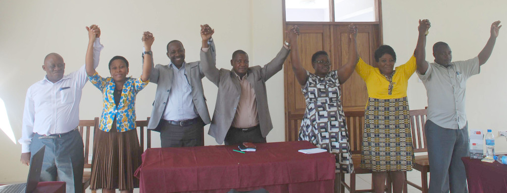 Picture of Stakeholders from Lushoto district DC, MAFC, VPO, IITA and PMO -RALG holding hands at the launching of the Lushoto district climate change Learning Alliance