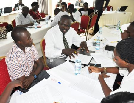 Picture of Participants deliberating during the workshop