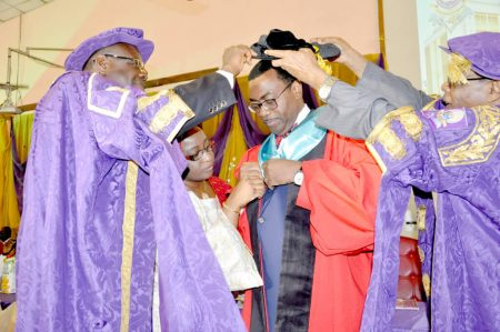 Picture of Dr Akinwumi Adesina receiving his cap and gown during the conferment ceremony.