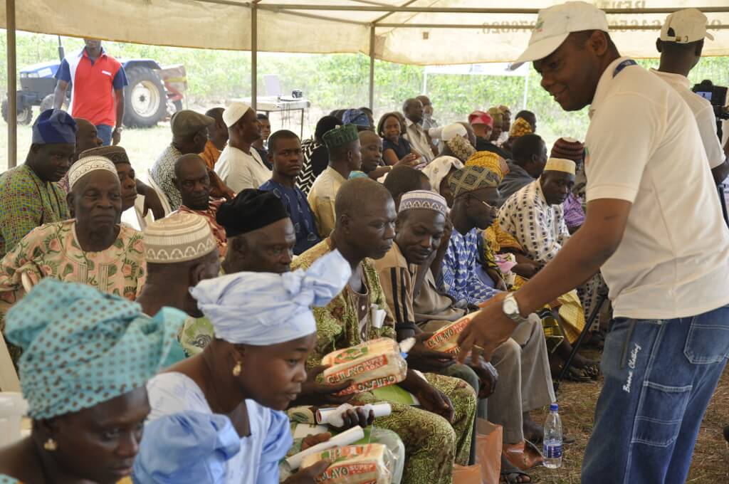 Picture of Gregory Nwaoliwe, HQCF Project staff, gives 10% HQCF-Wheat bread to participants during the field day.