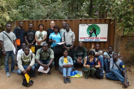 Participants in front of the gate to the 'Sanctuaire des singes de Drabo Gbo'.