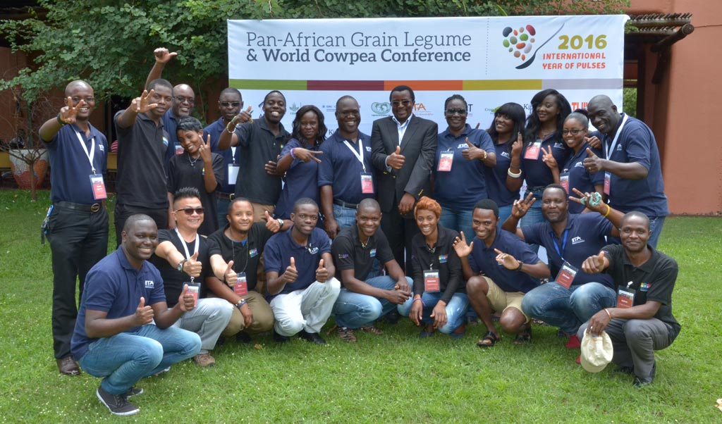 """Picture of The """"black and blue"""" conference crew with Dr Chikoye with an all thumbs-up for a successful conference at the close of the event on 4 March."""