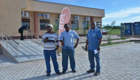 Picture of From left to right: Drs Ntawuruhunga, Chikoye, and Chigeza having a hearty laugh in front of the main science and admin block.