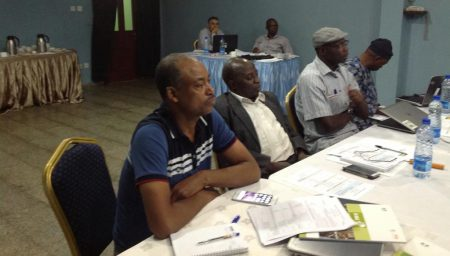 Picture of Chris Akem flanked by Commodity Specialists Sidi Sanyang and Solomon Assefa.