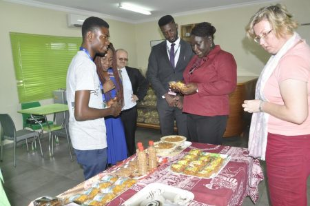 Picture of The Tony Elumelu Foundation delegation and IITA Management team interact with an IITA Youth Agripreneur