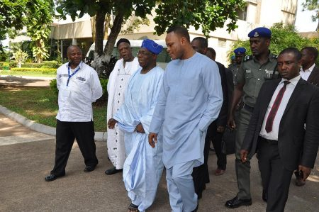 Picture of IITA DG Nteranya Sanginga (left) and former Nigerian President Olasegun Obasanjo (wearing blue headdress) with some government officials and partners.
