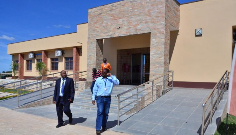Picture of David Chikoye (right) giving DG Sanginga a tour of IITA SARAH's main research and administration block