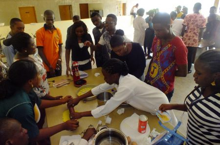 Picture of Youth Agripreneurs preparing food products during the training