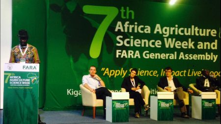 Kwesi Atta-Krah (left) leads panel discussion on sustainable productivity growth.