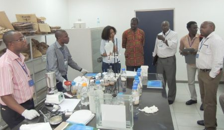 Picture of participants receive training on testing for aflatoxins