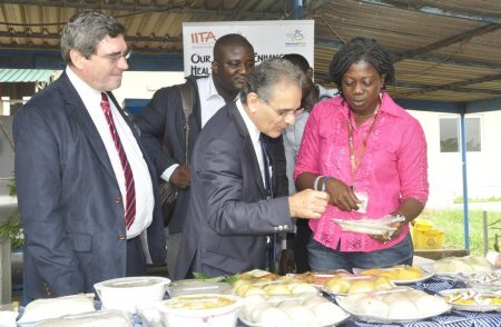 Picture of The IRD delegation tasting cassava food products at the cassava processing center in Ibadan.