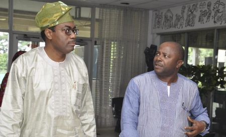 Picture of Akinwumi Adesina, AfDB president (left) and Nteranya Sanginga, IITA DG (right) discuss.