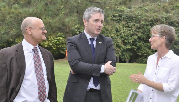 Picture of IITA DDG Partnership for Delivery Kenton Dashiell (left) and Lehmann listen attentively as Ylva Hillbur, IITA DDG Research (right), highlights major agricultural research activities at IITA.