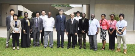 Picture of Sadanobu Kusaoke (center) flanked by DG Nteranya Sanginga (left), DDG Kenton Dashiell (right), DDG Kwame Akuffo-Akoto, Japanese scientists at IITA, members of staff and representatives of the IITA Youth Agripreneurs.