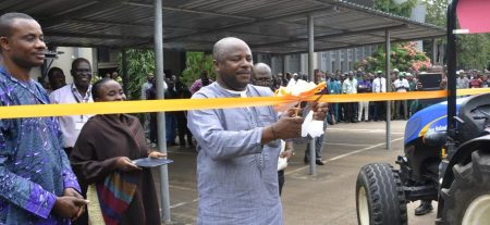 Picture of DG Sanginga cutting the tape to launch the equipment
