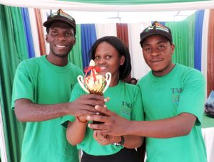 Picture of TYA representatives with the trophy they won at the national Agricultural show.