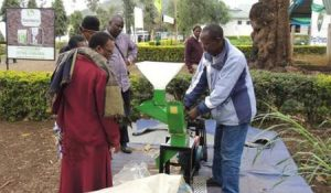 Picture of Ali, a beneficiary farmer from Matufa village-Babati demonstrates how the forage chopper machine operates.