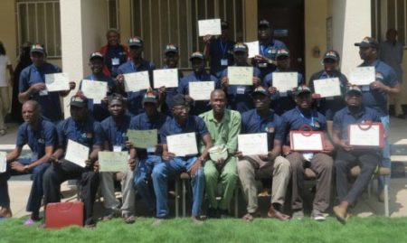 Picture of Northern Nigerian youths proudly display their certificates of completion
