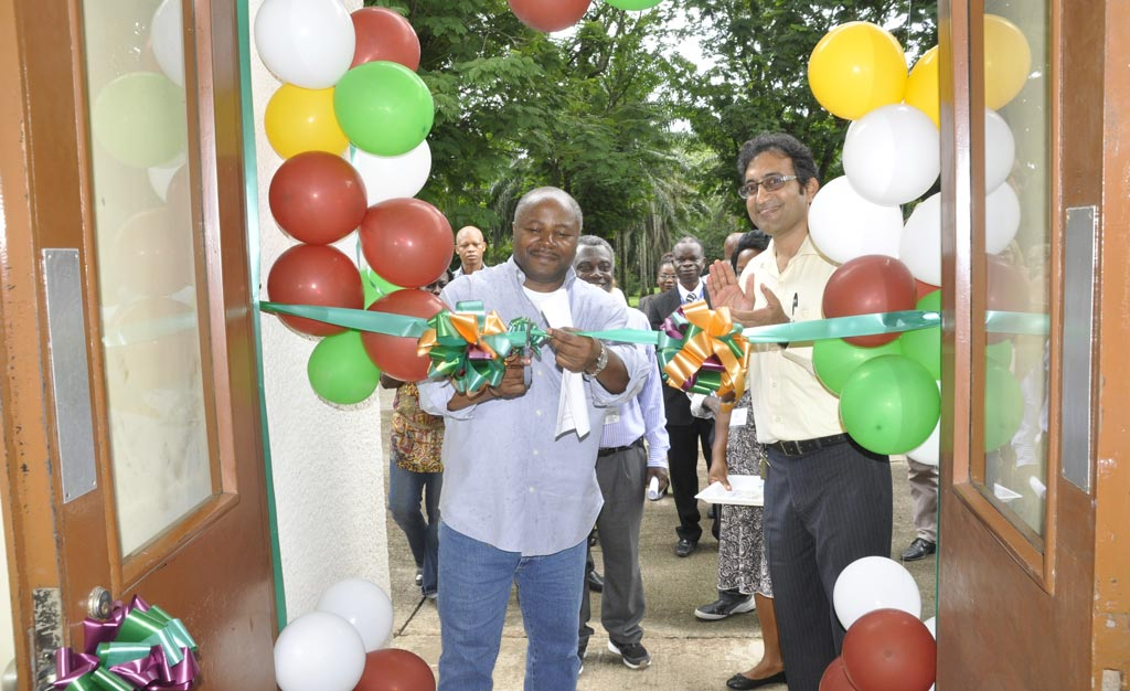Picture of DG Sanginga cutting the ribbon during the commissioning of the BASICS office, in IITA,Ibadan, with BASICS project coordinator Hemant Nitturkar.