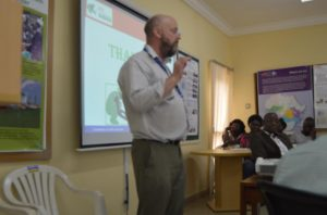 Picture of Dr. Abberton addressing scientists, Agripreneurs and staff in Abuja.
