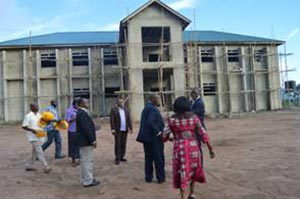 Picture of Tarawali leading the visitors to the Youth Training Center and Agripreneurs' Work Station that is under construction.