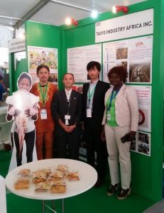 Picture of Youth Agripreneur Elizabeth (far right) with representatives from TIA at the exhibition booth
