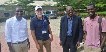 Picture of representative of IYA-Abuja, Per Hillbur, Gbassey Tarawali (Head of station), and Sadiq Gulma at the IITA-Abuja Station.