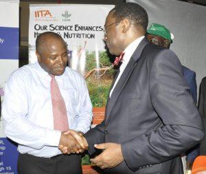 Picture of AfDB President Akinwunmi Adesina and DG Nteranya Sanginga shaking hands