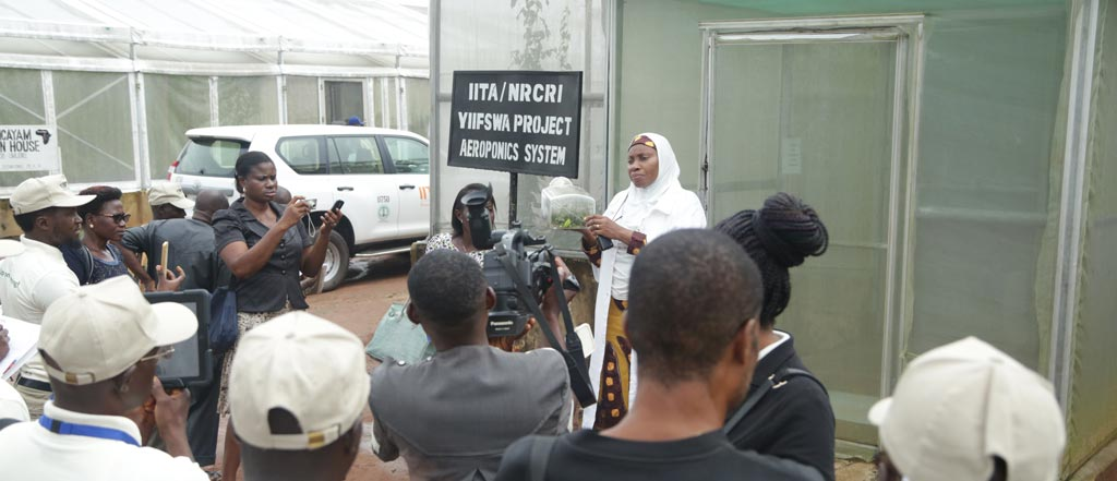 Picture of Dr Morufat Balogun addressing participants at the aeroponics facility at NRCRI.
