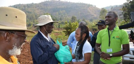 Picture of IKYA members giving some agroprocessing products to (L-R) the South-Kivu Governor HE Marcelin Chishambo Ruhoya and General Secretary Adolphe Mulumba.