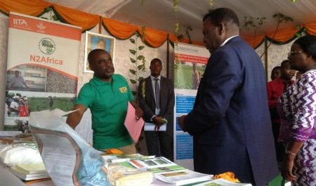 Picture of IITA's Alexander Nganga (left) briefing the Minister of Agriculture, Dr George Chaponda, about aflasafe.