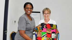 Picture of Ylva receiving a goodbye gift from Eveline Odiambo.