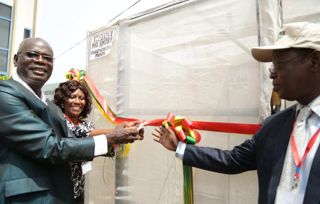 Picture of YIIFSWA Project Leader Norbert Maroya cutting the ribbon during the launch of the aeroponics system at CSIR-Ghana.