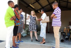 Picture of Hilde (middle) interacting with some staff members during her tour of the facilities in Tanzania.