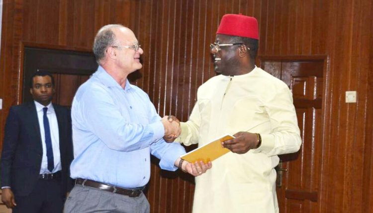 Picture of Kenton Dashiell, IITA DDG, Partnerships for Delivery (left), presents the implementation document of the Forum to His Excellency, Engr. Dave Umahi, the executive Governor of Ebonyi state.