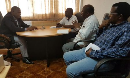 Picture of DG Sanginga meeting with DPA Dzucula (extreme left) while Chikoye and Boahen look on.