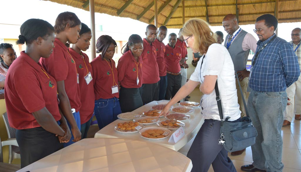 Picture of The ZIYA trainees presenting their cassava food products to Koper-Limbourg, Chikoye, and other IITA-Zambia staff