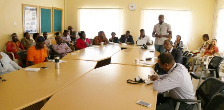 Picture of staff listening to presentations on IITA's yam R4D work.