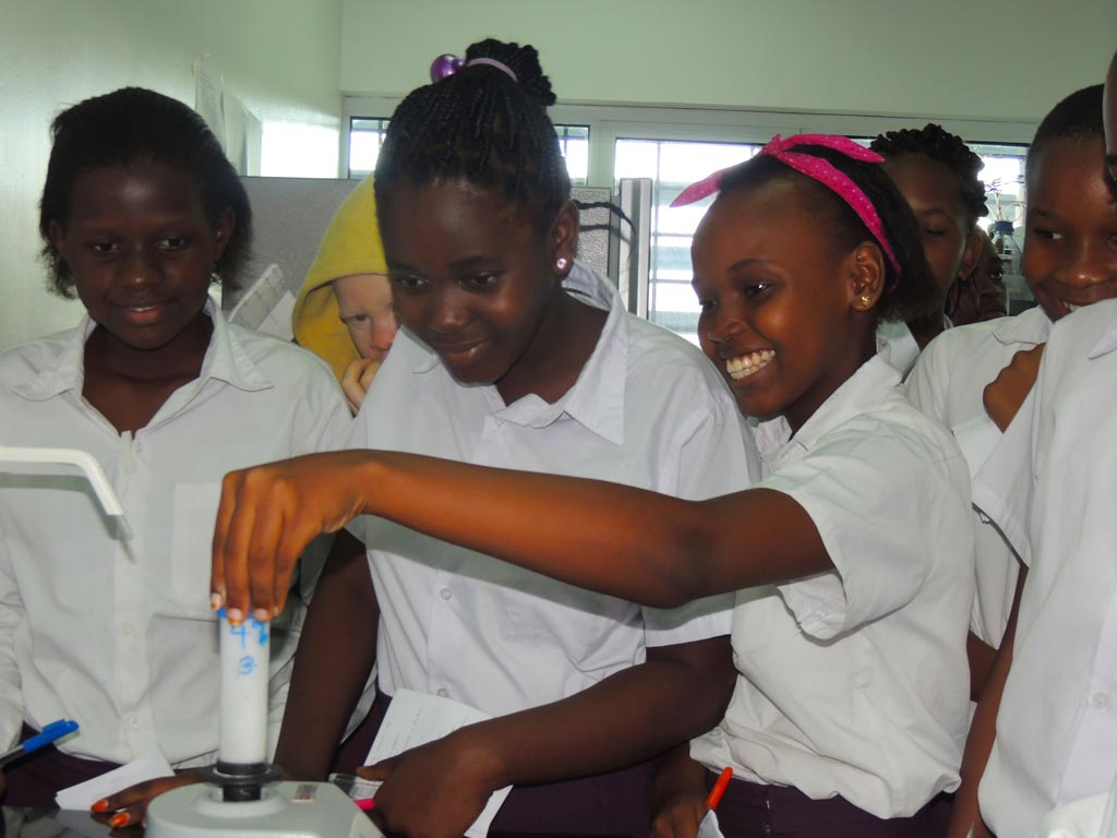 Picture of students getting an opportunity to use scientific equipment in the labs.
