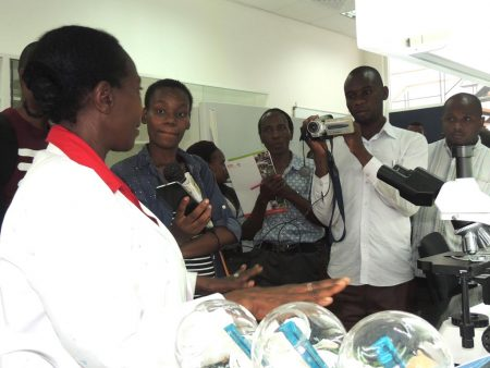 Picture of media interacting with staff at the Eastern Africa hub.