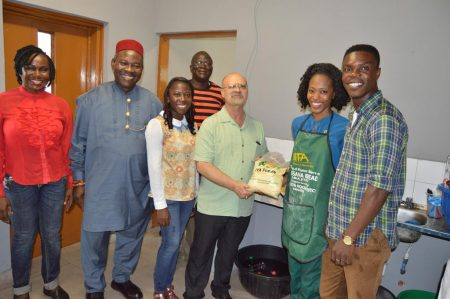 Picture of DDG with the Agripreneurs showing off some of the products.