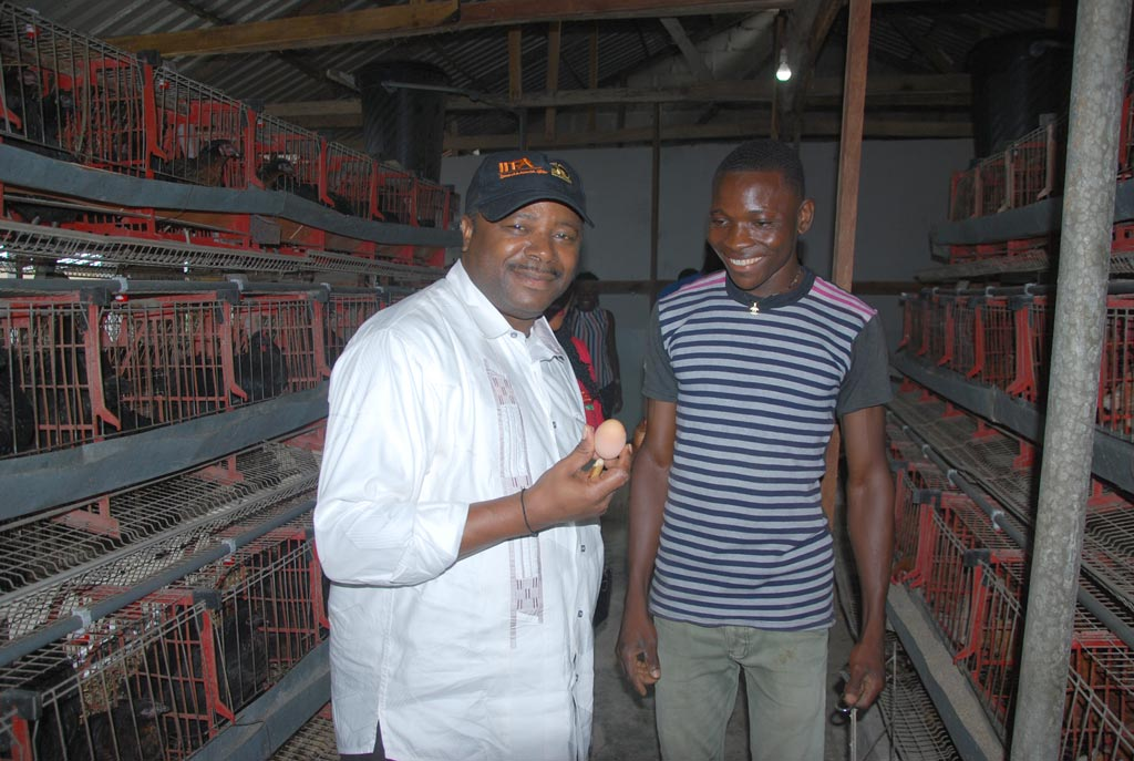 Picture of DG Nteranya Sanginga holds freshly laid egg