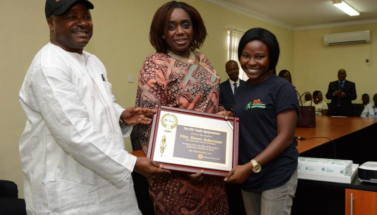 Picture of DG Sanginga and an Agripreneur presents a plaque to HE, Kemi Adeosun.