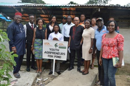 Picture of Director Chiji (center, in black) flanked by the youth agripreneurs and staff in Onne.