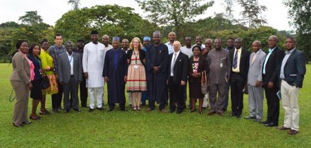 Picture of the Minister of State for Environment and his officials in a group photo with IITA staff.
