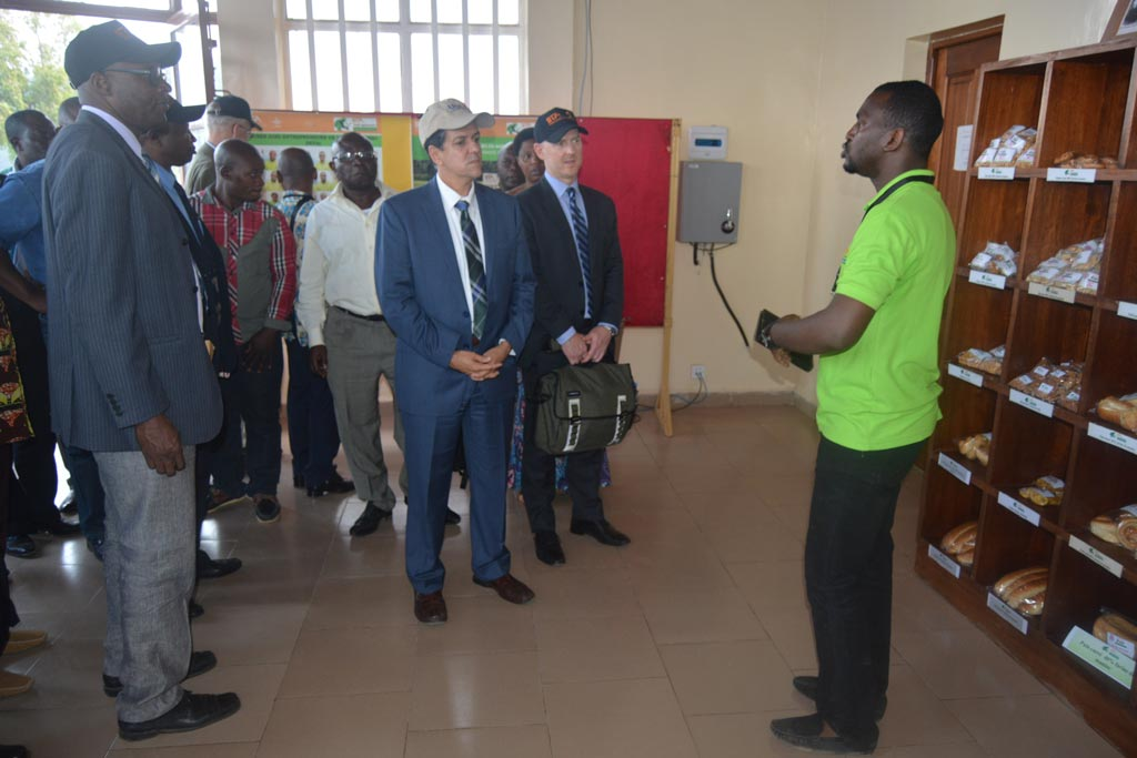 Picture of Christopher Tocco (center) with other USAID delegates and event participants at the youth Agripreneurs exhibition center.
