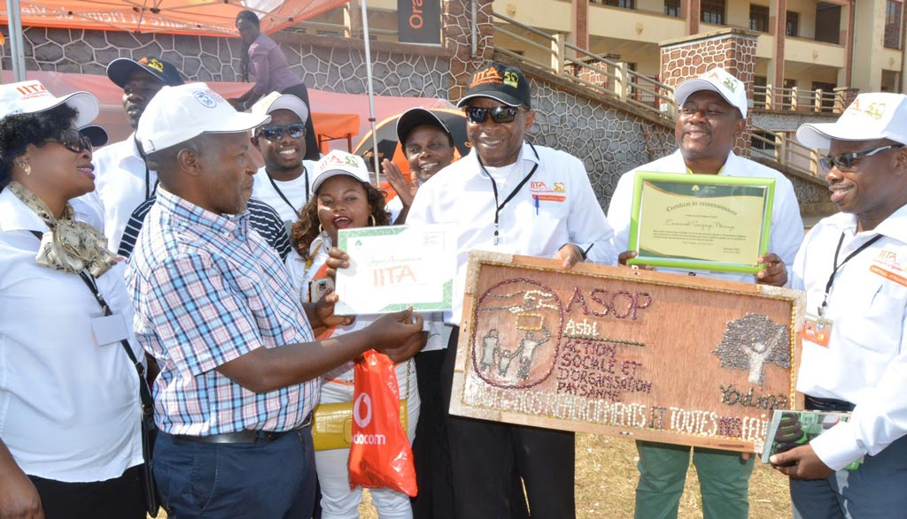 Picture of Chris Okafor, OiC, IITA in Kalambo accepting an award on behalf of IITA at the ceremony.