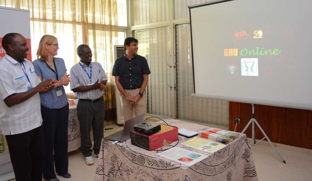 Picture of Tonny Omwansa, Director, Research Support; Hilde Koper, Deputy Director General, Corporate Services; and Robert Asiedu, Director, West Africa Hub, and Lava Kumar, Head Germplasm Health Unit, launch GHU Online.