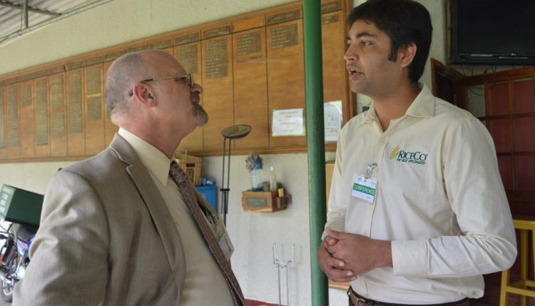 Picture of Dr Ken Dashiell (left) speaking to Shanni Srivastava of UPL, an agrochemical company.