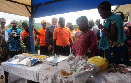 Picture of Ananga Messina, who represented the Minister of Agriculture and Rural Development, at the event tasting some finshed and nutritious food products from IITA staple crops.